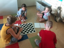 Come up with several ways to figure out how many spaces there are on a chess board.